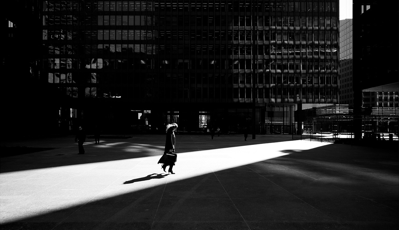 Woman standing in ray of light