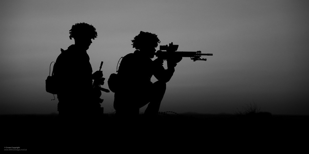 Soldiers of 2 Royal Anglian Silhouetted in Afghanistan